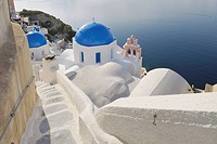 Greece, View of whitewashed church and bell tower at Oia village
