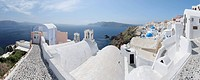 Greece, View of Oia village with cobbled path and bell tower at Santorini