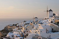 Greece, View of Oia village with traditional Greek windmills at Santorini