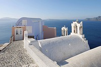 Greece, View of Oia village with bell tower of Greek Orthodox Church at Santorini