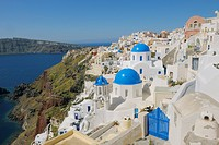 Greece, Santorini, View of classical whitewashed church and bell tower at Oia