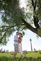 Germany, North Rhine Westphalia, Duesseldorf, Couple embracing, smiling