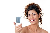 Young woman clicking her own picture using her mobile phone