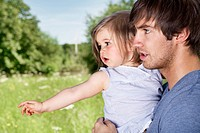 Germany, Cologne, Father and daughter in meadow
