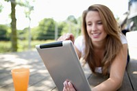 Europe, Germany, North Rhine Westphalia, Duesseldorf, Young student with digital tablet, smiling