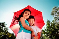 A girl and a boy under the umbrella