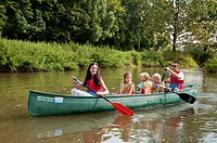 Family in canoe / canoeing, pleasure trip