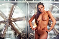 very sexy top model fully nude on a stage with huge turbo fan be