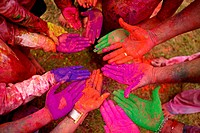 Top angle view of human hands smeared with holi colours
