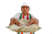 Indian politician holding currency notes