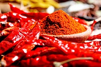 Close up of chili powder and red chilies