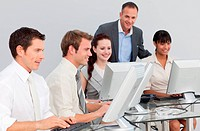 Multi_ethnic business people and ma ger working with computers in an office