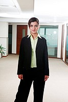 Businesswoman standing in office, portrait
