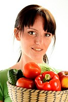 Young woman holding dish with vegetables on white background