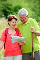 Closeup of senior couple rambling in countryside with map