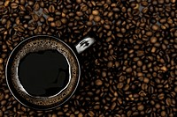 black mug of coffee and scattered beans