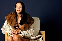 woman in furs with wine.