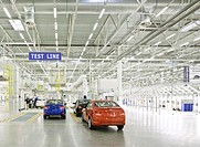 New cars leaving a factory