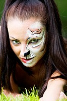 Woman with tigress face art portrait