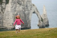 little girl dancing on the top of cliff, Etretat, Cote d´Albatre, Pays de Caux, Seine-Maritime department, Upper Normandy region, France, Europe