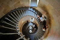 Tourists climbing spiral staircase inside the lighthouse Phare des Baleines on the island Ile de Ré, Charente_Maritime, France