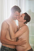 Pregnant woman and man embracing