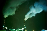 smokestacks at night