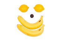 Fruit like man´s face. Lemon, banana and grape