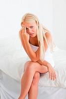 Portrait of a sick blonde woman