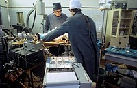 Operating theatre. Surgeons operating on a patient at the Central Tuberculosis Scientific Research Institute, Moscow, Russia. Photographed in 1985.