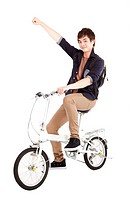 Happy asian young man on a bicycle isolated on whi