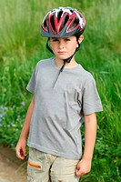 portrait of small boy bicyclist with helmet
