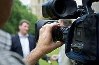 Man holding a film camera