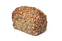 Whole loaf of Pumpkin seed bread on white background