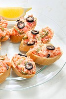 salmon tartare with capers and black olives