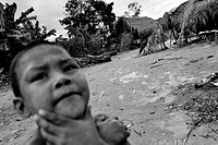 A young Nukak boy stands in front of the shacks in a refugee settlement close to San Jose del Guaviare, Colombia, 4 September 2009  The Nukak Maku peo...
