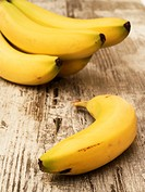 Ripe bananas on wooden table