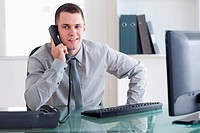 Businessman listening carefully to caller