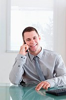 Happy businessman listening to caller
