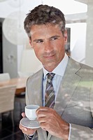 Businessman drinking coffee