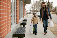 Father and son walking home from shopping errands