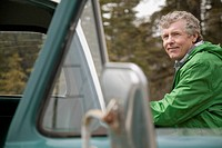 Portrait of middle_aged man by old truck