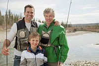 Portrait of three generations of men fishing