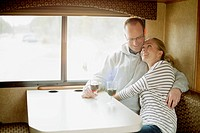 Couple having some wine in camper