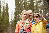 Family portrait with cell phone
