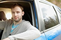 Portrait of mid_adult man sitting in car