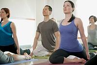 Yoga class stretching.