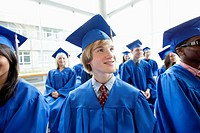 Graduates listening to speaker during grad ceremony