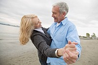 Mature couple dancing on the beach (thumbnail)