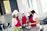 Mother cooking with daughters 6_7, 10_12